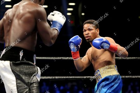 Shawn Porter, right, in action against Andre Berto during their welterweight fight on in Brooklyn, NY. Porter won via 9th round TKO