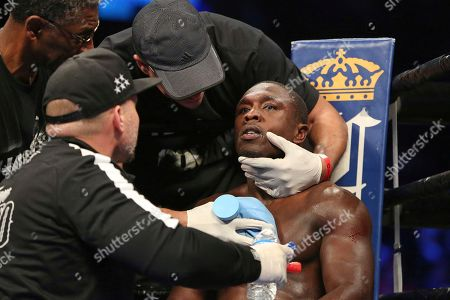 Stock Image of Andre Berto is seen in his corner between rounds against Shawn Porter during their welterweight fight on in Brooklyn, NY. Porter won via 9th round TKO