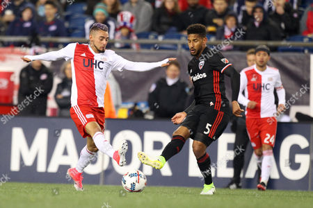 , 2017; Foxborough, MA, USA; New England Revolution forward Juan Agudelo (17) and D.C. United defender Sean Franklin (5) in action during the first half of an MLS game between D.C. United and New England Revolution at Gillette Stadium. The game ended in a 2-2 draw