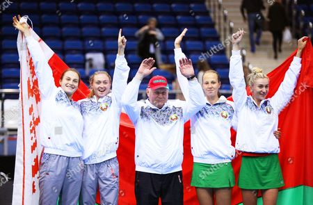 Belarus' Fed Cup team members (L-R) Aryna Sabalenka, Aliaksandra Sasnovich, team captain Eduard Dubrou, Vera Lapko, and Olga Govortsova celebrate after winning the Fed Cup 2017 World Group semi final tie between Belarus and Switzerland in Minsk, Belarus, 23 April 2017.