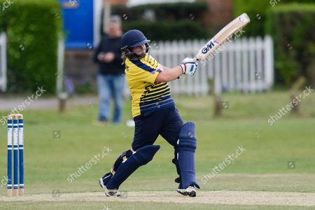 Stock Photo of Charlotte Taylor of Hampshire batting during the ECB WOMEN'S County Championship pre-season friendly match between Hampshire CCC Women and Middlesex CCC Women at Hartley Wintney Cricket Club, Hartley Wintney