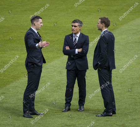 Lee Wallace of Rangers, Rangers assistant manager Helder Baptista & assistant coach Jonatan Johansson chat on the pitch before the William Hill Scottish Cup semi-final tie between Rangers & Celtic at Hampden Park on 22nd April