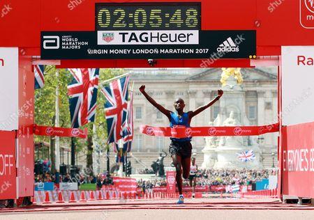 Kenya's Daniel Wanjiru wins the men's Elite in 02.05.48 at the finishing line of the London marathon in the Mall, London, Britain, 23 April 2017.