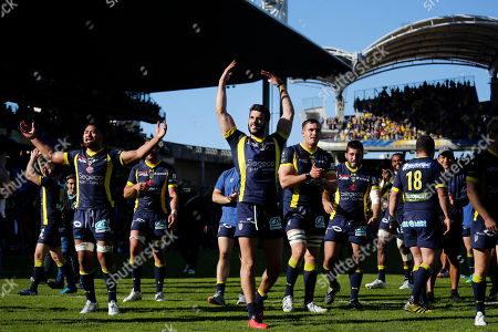 Stock Photo of Clermont's Patricio Fernandez, center, celebrates with his teammates after they won their European Rugby Champions Cup semifinal match against Leinster at Gerland stadium, in Lyon, central France