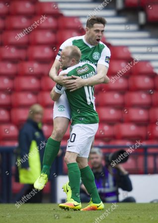 Grant Holt of Hibernian celebrates with Dylan McGeouch of Hibernian after scoring their first goal shortly after coming on as a substitute for Fraser Fyvie during the William Hill Scottish Cup semi-final tie between Hibernian & Aberdeen played at Hampden Park, Glasgow on 21st April