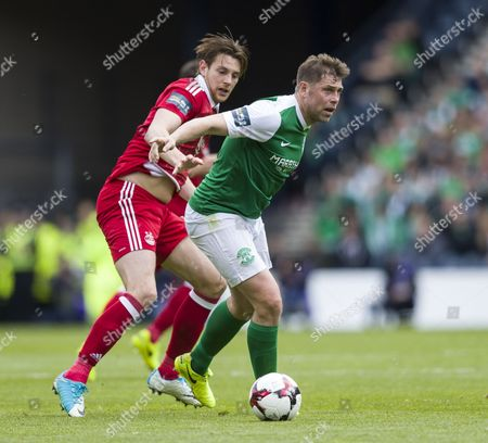 Grant Holt of Hibernian challenged by Ashton Taylor of Aberdeen during the William Hill Scottish Cup semi-final tie between Hibernian & Aberdeen played at Hampden Park, Glasgow on 21st April