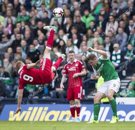 Adam Rooney of Aberdeen flies over Grant Holt of Hibernian during the William Hill Scottish Cup semi-final tie between Hibernian & Aberdeen played at Hampden Park, Glasgow on 21st April