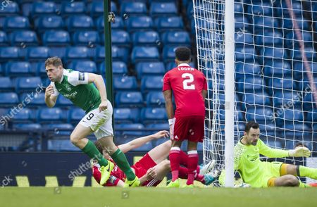 Grant Holt of Hibernian celebrates scoring their first goal shortly after coming on as a substitute for Fraser Fyvie during the William Hill Scottish Cup semi-final tie between Hibernian & Aberdeen played at Hampden Park, Glasgow on 21st April