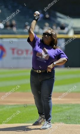 Rhonda McCullough, widow of Chicago actor Bernie Mac, throws out a ceremonial first pitch before a baseball game between the Cleveland Indians and the Chicago White Sox in Chicago
