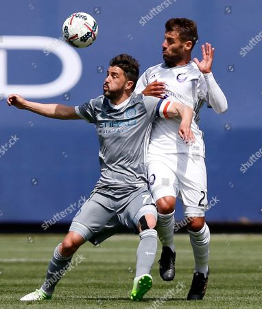David Villa, Antonio Nocerino New York City FC forward David Villa (7), of Spain, and Orlando City SC midfielder Antonio Nocerino (23), of Italy, vie for the ball during the first half of an MLS soccer game, in New York