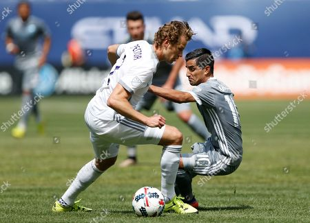 Jonathan Spector, Maximiliano Moralez Orlando City SC defender Jonathan Spector (2) and New York City FC midfielder Maximiliano Moralez (10), of Argentina, vie for the ball during the first half of an MLS soccer game, in New York