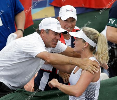 United States' CoCo Vandeweghe, right, gets a hug from her coach Craig Cardon, left, as Lisa Raymond, Fed Cup team coach, center, looks on after she defeated Czech Republic's Katerina Siniakova in a Fed Cup semifinal tennis match, in Wesley Chapel, Fla