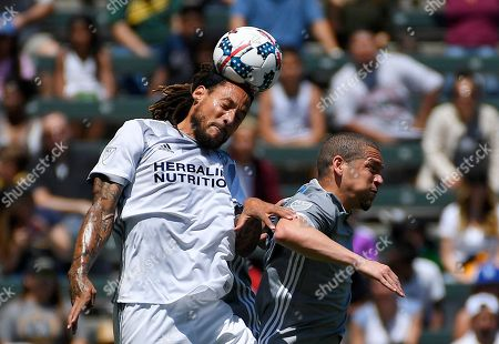 Jermaine Jones, Osvaldo Alonso Los Angeles Galaxy midfielder Jermaine Jones, left, heads the ball as Seattle Sounders midfielder Osvaldo Alonso jumps alongside during the first half of a MLS soccer match, in Carson, Calif