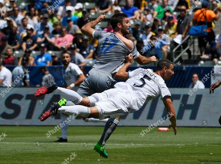 Daniel Steres, Will Bruin Los Angeles Galaxy defender Daniel Steres, right, pulls the shirt of Seattle Sounders defender Will Bruin as he falls during the first half of a MLS soccer match, in Carson, Calif