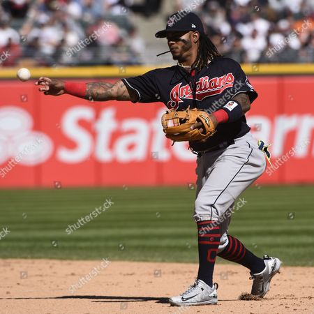 Cleveland Indians second baseman Michael Martinez (1) fields a ball hit by Chicago White Sox's Leury Garcia during the seventh inning of a baseball game in Chicago on