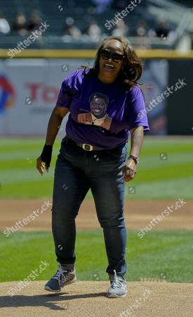 Stock Photo of Rhonda McCullough, widow of Chicago actor Bernie Mac, smiles after she throws out a ceremonial first pitch before a baseball game between the Cleveland Indians and the Chicago White Sox in Chicago on