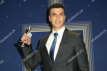 Stock Image of Elias Anton poses with the 'Graham Kennedy Award for Most Outstanding Newcomer' Logie Award.