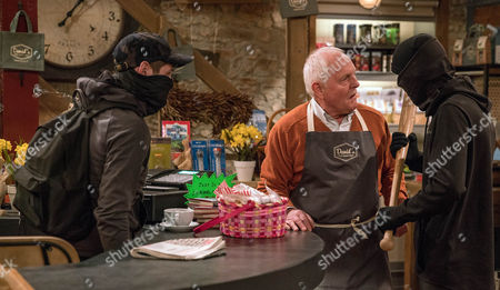 Josh and Jamie, covered in hoods, they enter the shop and demand cash from Pollard, as played by Christopher Chittell. When he stands up to them, they hit him in the stomach with a baseball bat as a frightened Dan watches on, frozen to the spot. (Ep 7816 - Thur 4 May 2017)