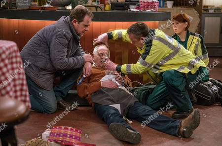 Dan Spencer, as played by Liam Fox, calls an ambulance, ashamed by his failure to step in. Is Pollard, as played by Christopher Chittell, ok? (Ep 7817 - Thur 4 May 2017)