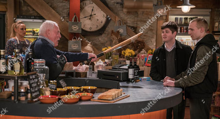 Josh, as played by Conner Chapman, and Jamie, as played by Jake Hayward, return to the shop and rile Pollard, as played by Christopher Chittell, who reaches for the cricket bat. (Ep 7820 - Tue 9 May 2017)