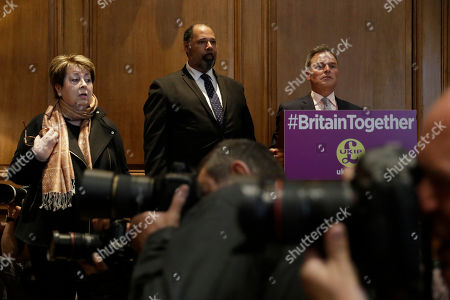 The UK Independence Party's, from left, Margot Parker equalities & women's issues spokesperson, David Kurten education spokesperson and deputy leader Peter Whittle take questions from journalists as photographers point their cameras at the party leader Paul Nuttall sat listening, during their policy announcement press conference for Britain's upcoming general election at a hotel in London