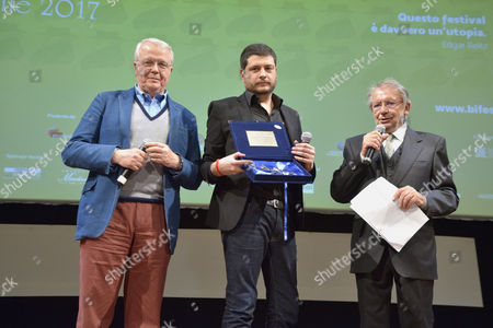 Stock Photo of The director Claudio Giovannesi, prize Best Director with Marco Mereghetti journalist and Felice Laudadio