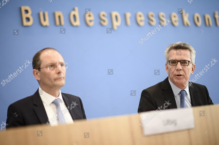 German Interior Minister Thomas de Maiziere (R) and Saxony State Minister of the Interior, Markus Ulbig, during a press conference on the report on police crime statistics 2016 in Berlin, Germany, 24 April 2017.