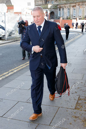 Stock Image of Former Rangers player and manager Ally McCoist leaves the court.