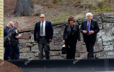 Linda Kenney Baden, center, a defense attorney for Aaron Hernandez, arrives with her husband, right, forensic pathologist Michael Baden, for a private service for Hernandez at O'Brien Funeral Home, in Bristol, Conn. The former New England Patriots tight end was found hanged in his cell in a maximum-security prison Wednesday