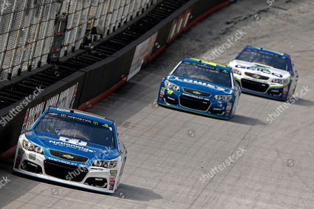 Driver Dale Earnhardt Jr., Jimmie Johnson, Ty Dillon Driver Dale Earnhardt Jr.(88) leads driver Jimmie Johnson (48) and Ty Dillon during practice for a NASCAR Monster Energy NASCAR Cup Series auto race, in Bristol, Tenn