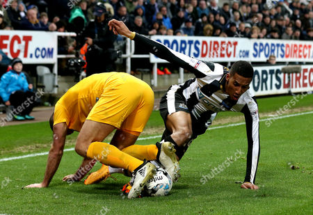 Isaac Hayden of Newcastle United challenges Tommy Spurr of Preston North End