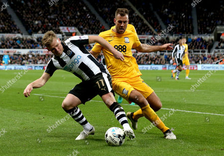 Matt Ritchie of Newcastle United takes on Tommy Spurr of Preston North End