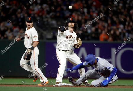 Yasiel Puig, Brandon Crawford San Francisco Giants shortstop Brandon Crawford, center, throws to first base after forcing out Los Angeles Dodgers' Yasiel Puig, right, at second base on a ground ball from Chase Utley during the fifth inning of a baseball game, in San Francisco. Utley was safe at first base