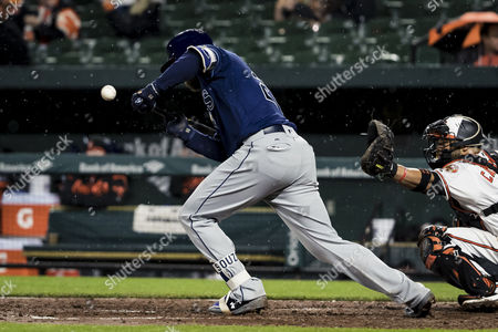 Tampa Bay Rays right fielder Steven Souza Jr. (20) gets hit while trying to bunt during MLB game between Tampa Bay Rays and Baltimore Orioles at Oriole Park at Camden Yards in Baltimore, Maryland