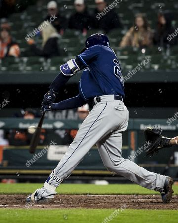 Tampa Bay Rays right fielder Steven Souza Jr. (20) gets his bat on the ball during MLB game between Tampa Bay Rays and Baltimore Orioles at Oriole Park at Camden Yards in Baltimore, Maryland