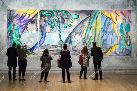 Visitors view Turner prize-winning artist CHRIS OFILI new tapestry titled The Caged Bird's Song