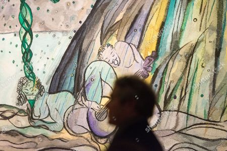 Visitor views Turner prize-winning artist CHRIS OFILI new tapestry titled The Caged Bird's Song