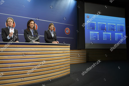(L-R) UEFA chairwoman Women's Football Committee Karen Espelund, next to UEFA Women's football advisor Nadine Kessler, and UEFA Women's competitions manager Anne Vonnez, shows a ticket of Spain national team, during the drawing of the matches for the 2017-19 European Qualifying Competition for the FIFA Women's World Cup at the UEFA headquarters in Nyon, Switzerland, 25 April 2017. The FIFA Women's Cup will take place in France 2019.