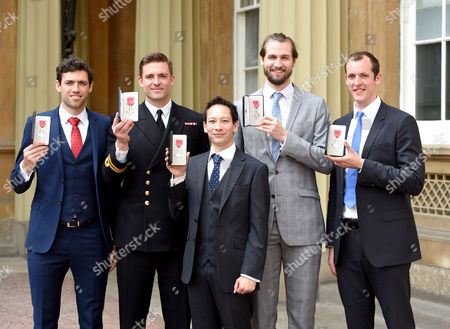 Matthew Gotrel, Lieutenant Pete Reed, Phelan Hill, Paul Bennett, Scott Durant during Investitures at Buckingham Palace London