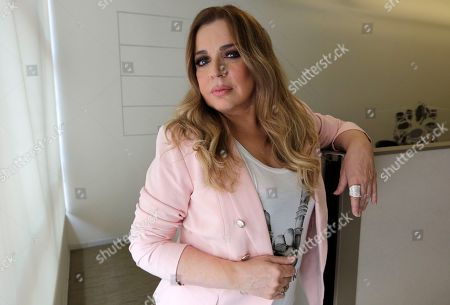 """Musician Ednita Nazario, of Puerto Rico, poses for a photograph in Miami. Nazario is releasing this a memoir and CD, both titled """"Una vida"""" (A Life.) The book was published on Tuesday. The album comes out Friday"""