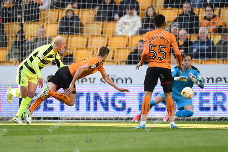 Dean Whitehead of Huddersfield Town has a shot on goal during the Sky Bet Championship match between Wolverhampton Wanderers and Huddersfield Town played at the Molineux Stadium, Wolverhampton on 25th April 2017