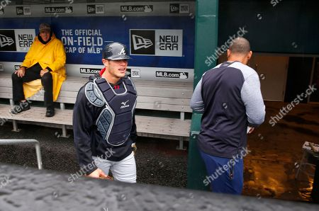 Stock Image of Anthony Recker, Matt Kemp Atlanta Braves catcher Anthony Recker, center, and outfielder Matt Kemp, right, head to the clubhouse to wait for news on whether their scheduled baseball game against the New York Mets would be played, in New York. The game was postponed due to rain