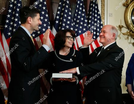 Paul Ryan, Ron Estes, Susan Estes House Speaker Paul Ryan, left, of Wis., conducts a a ceremonial swearing-in ceremony for Representative-elect Ron Estes, R-Ks., accompanied by his wife Susan Estes, center, at the Capitol in Washington