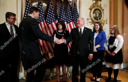 Paul Ryan, Ron Estes House Speaker Paul Ryan of Wisconsin greets Representative-elect Ron Estes, R-Kan., accompanied by his family during a ceremonial swearing-in ceremony at the Capitol in Washington