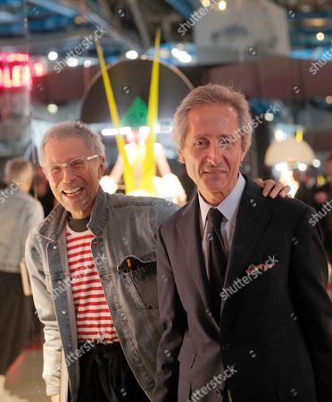 Stock Image of French photogrpaher Jean-Paul Goude, left, and French National Modern Art Museum Director Bernard Blistene pose before the dinner of the Societe des amis du musee national d'art moderne (Friends' society of the national Museum of modern art) held at the centre Pompidou in Paris, France