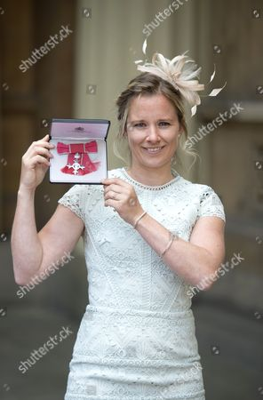 Sailor, Hannah Mills with her MBE