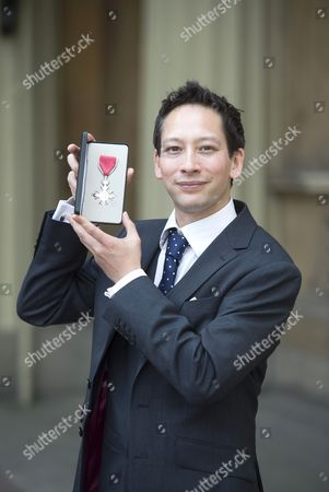 Rowing Cox Phelan Hill with his MBE