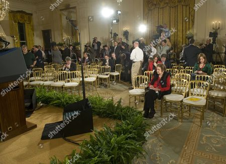 Helen Thomas, White House Correspondent, sits in her traditional front row seat of the  East Room