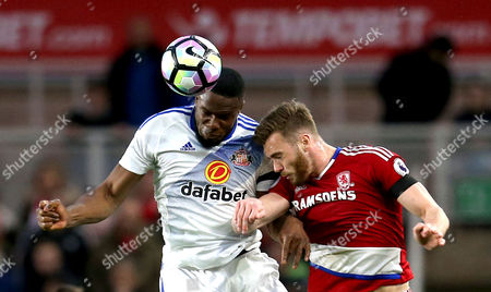 Victor Anichebe of Sunderland challenges Calum Chambers of Middlesbrough to a header