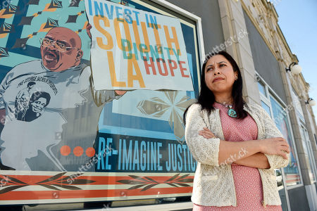 Aurea Montes-Rodriguez, executive vice president of Community Coalition, poses for a portrait outside the Community Coalition offices, in Los Angeles. There may have been a riot going, but 16-year-old college-bound Montes-Rodriguez had a field trip to Washington, D.C., to prepare for, so she wasn't about to miss class on April 30, 1992. That's where she was when word came down that things had gotten so bad on the riot's second day that the city was shutting down bus service. She'd have to walk three miles past scores of burning buildings to get home